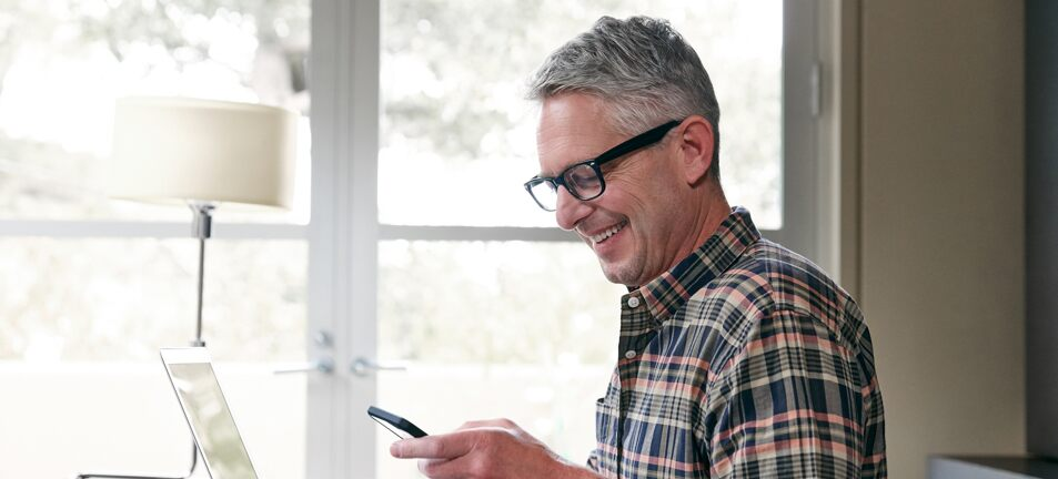Mature male reading his phone