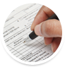 Close up of Person�s Hand Holding a Pen Filling out Tax Forms