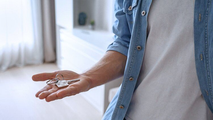 Man holding key to new apartment