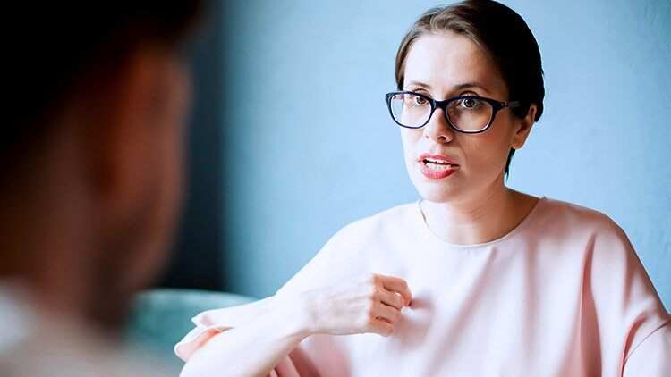 Woman having serious discussion with man