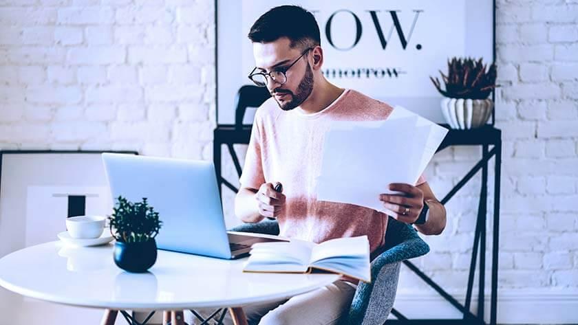 man-home-laptop-notebook-paperwork