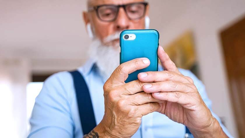 senior-man-with-white-hair-using-cellphone