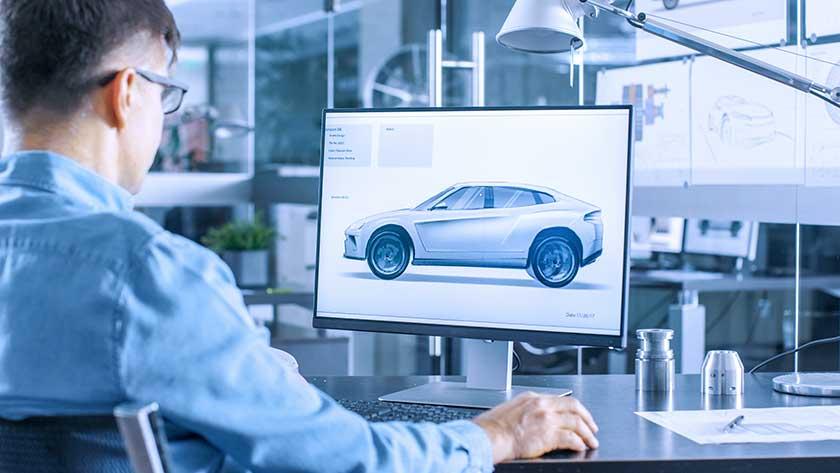 engineer-designer-looking-at-car-on-computer