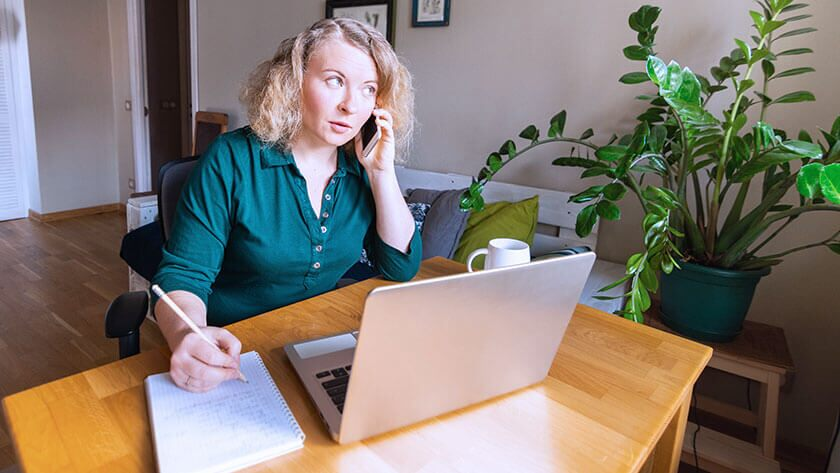 woman-talking-on-phone-home-office