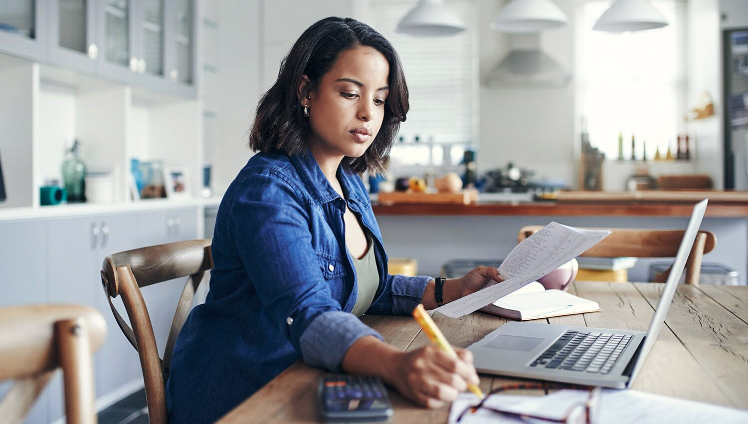 A woman works on her LLC operating agreement from home