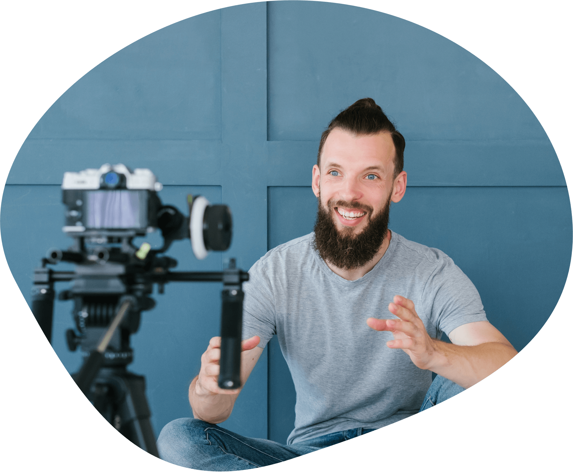 man using video camera on blue background