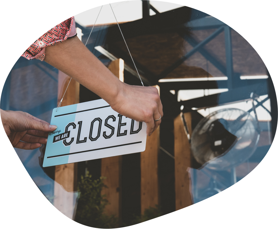 Company Dissolution - closed sign on retail shop